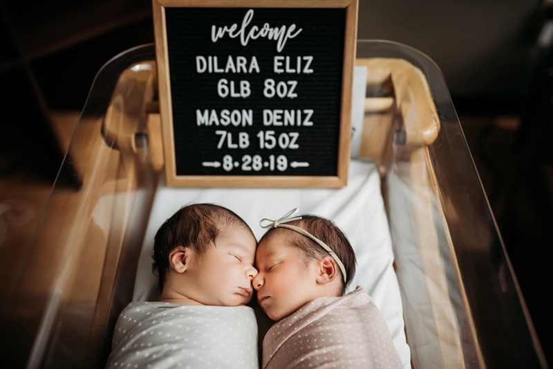 Fresh 48 Photography,  baby twins sleep nose to nose in hospital bassinet