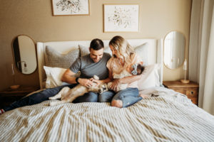 Lifestyle Newborn photo session in home, baby and dog